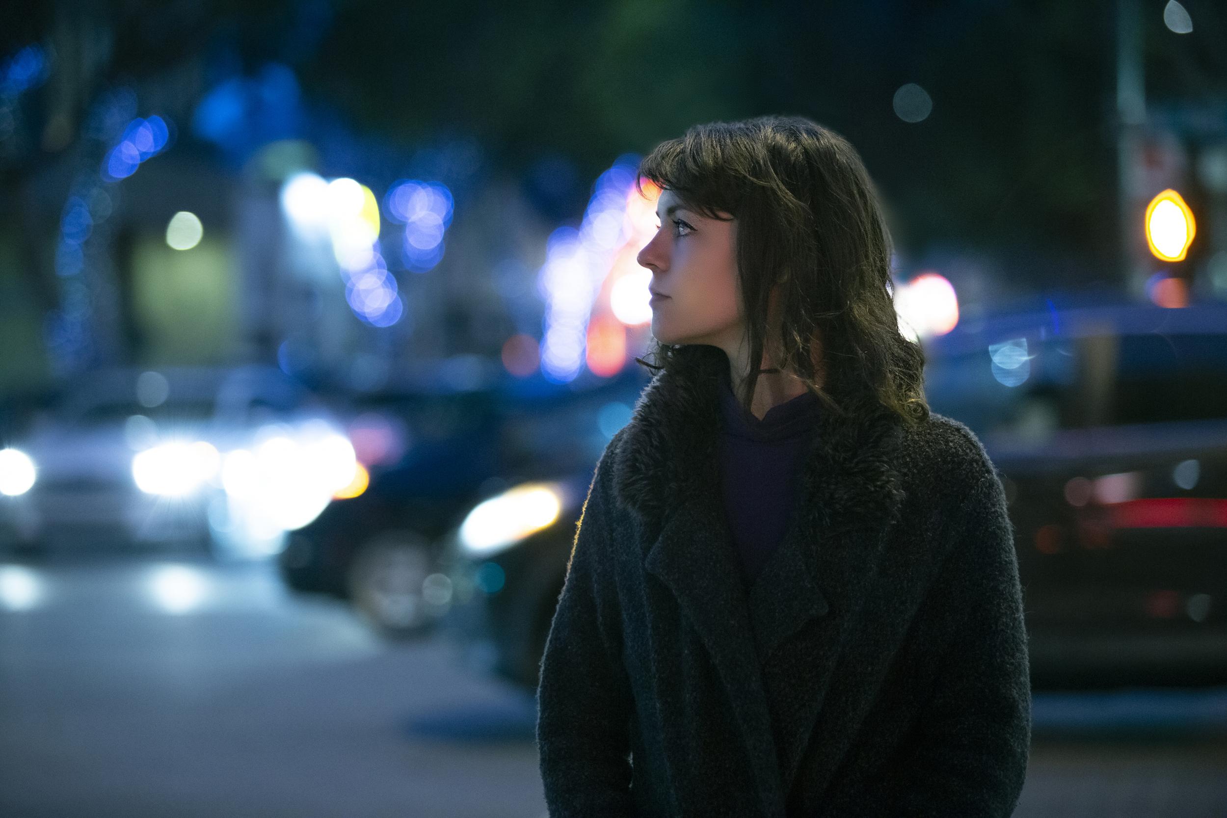 Woman walking at night city